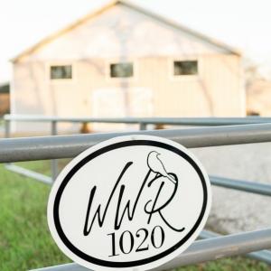 A view from the street toward the modern farmhouse wedding venue in Leonard, TX