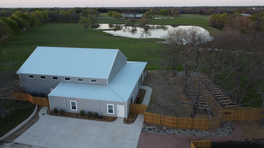 waterfront view of farmhouse wedding venue